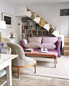 liking how there is no railing on the stairs. and the plum sofa.