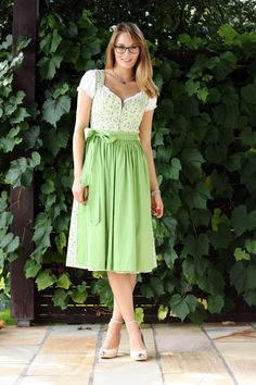 Beautiful greenish Dirndl, matching ankle-strap peeptoes. Gorgeous glasses.