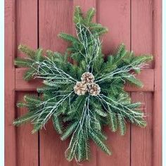 Wreaths don't have to be round. Greenery and pine cones come together in a beautiful snowflake shape to adorn your door.