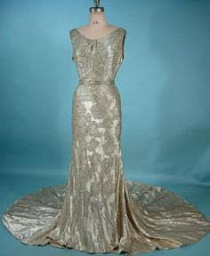 Circa 1930's The Liberty Shop, New Orleans, LA--magnificent satin rhinestone and beaded trained gown with original matching belt.  The Liberty Shop, 2220 St. Charles Avenue, New Orleans, was founded by two Southern ladies--Mrs. E.M. Ragan and Miss Emily Guelton in 1920, and headquartered in a mansion that still stands (currently a bridal shop).  The shop imported gowns, as well as designed and created their own couture creations.