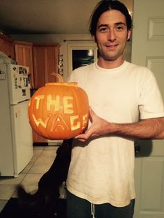 "Submitted by Zach Swain (Fall 2015) -- I chose to carve ""Raise the Wage"" into my pumpkin because my roommate and I got into a debate about whether it was a good economic policy to raise minimum wage.  At the end, we agreed to disagree."