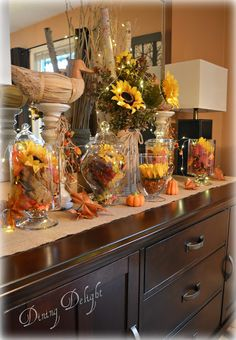 As mentioned in my last post, here's a look at how I coordinated the fall decor on my sideboard with that on my Thanksgiving tablescape . Harvest Decorations, Fall Mantel Decorations, Seasonal Decor, Autumn Centerpieces, Fall Home Decor, Autumn Home, Home Decor Items, Thanksgiving Tablescapes, Thanksgiving Decorations