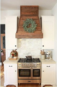 """I love how covered her hood for her range vent in wood. I think I've showed this image to my husband at least 100 times. Kitchen Redo, Kitchen Remodel, Kitchen Dining, Kitchen Stove, Kitchen Fan, Kitchen Ideas, New Kitchen Inspiration, Oven Hood, Oven Vent"