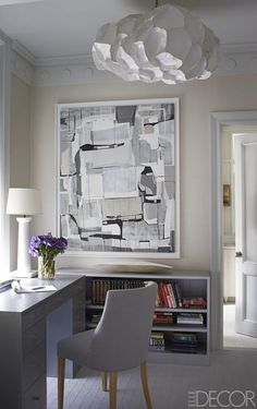 The study off the master bedroom features a chair upholstered in a Zimmer + Rohde fabric and a painting by James Kennedy; the walls are covered in a vinyl by Innovations.