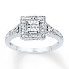 This enchanting sterling silver ring for her is packed with vintage-inspired details. A central diamond is framed in smaller diamonds and milgrain detailing to form the centerpiece, while additional diamonds decorate the band for a total diamond weight of 1/20 carat. Diamond Total Carat Weight may range from .04 - .06 carats.