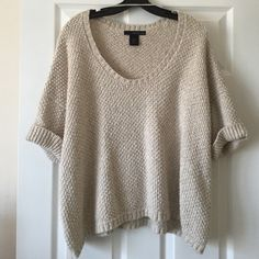 FINAL PRICE Calvin Klein Cream Sweater NEW PHOTOS POSTED Warm, loose fitting cream sweater with 3/4 length sleeves. It works really well when you still want to be warm, but it's not cold enough for your winter clothes! Calvin Klein Sweaters Crew & Scoop Necks