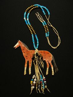 Modern reproduction of a Plains Indian rawhide horse amulet necklace.