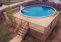 Small round above ground composite pool deck for small backyard