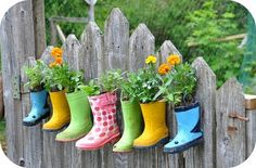 Gardening in the rain . . . boots. Just visit a thrift shop to acquire the boots. You can also set them on the deck if you do not want to hang them from the fence.