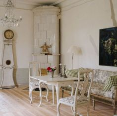 Traditional Swedish Gustavian room with Mora clock and kakelugn, the energy efficient, Swedish-invented tiled stove.