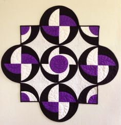 I saw the pattern for this quilt (Rythmic by Sew Karen-ly Created) and was so taken by its contrast of colors and use of circles and angles....