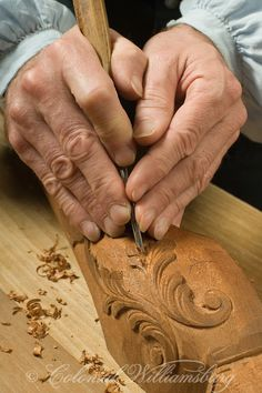 Carving wood at the Cabinetmaker's, Williamsburg, VA, Photo by Tom Green