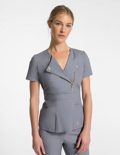 The Moto Top in Graphite is a contemporary addition to women's medical scrub outfits. Shop Jaanuu for scrubs, lab coats and other medical apparel. Spa Uniform, Scrubs Uniform, Scrubs Pattern, Stylish Scrubs, Cute Scrubs, Scrubs Outfit, Medical Uniforms, Uniform Design, Medical Scrubs