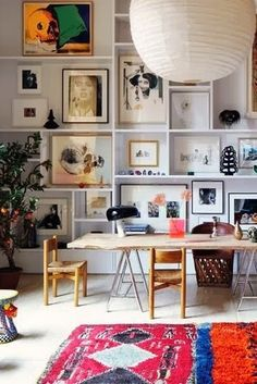 That is one great gallery wall! // love how the framed art is 'framed' by the shelves. so cool.