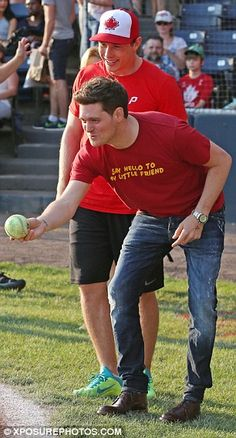 Bonding: Michael was later seen pitching the ball to his son as the crowd looked on smilin...