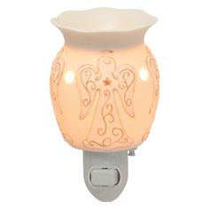 Heavenly Plug-In Scentsy Warmer A creamy base encircled with angels. Matte porcelain finish with gold highlights. Heavenly Plug-In Scentsy Warmer A creamy base encircled with angels. Matte porcelain finish with gold highlights. Scentsy Plug In Warmers, Gold Highlights, Solid Perfume, Jar Lamp, Confectionery, Night Light, Plugs, The Balm, Porcelain