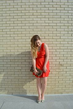 Red fit and flare dress with leopard clutch and gold pumps for the perfect Valentine's day look on sophisticaited.com