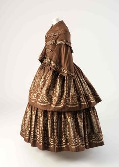 OBJECT 40 - Brown and cream silk dress with flounces woven à disposition, 1850s. Fashion Museum Bath.
