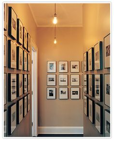 Hallways are the perfect place to create photo galleries. The wall space is begging to be used and there is always guaranteed foot traffic. Take your favorite pictures, turn them into black and whites or play with the saturation and turn your hallway into a walk down memory lane. via Stylish Ideas for Displaying Family Photos.