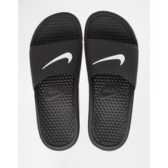 Sandals by Nike Lightweight water resistant upper Single branded strap Slip-on design Textured insole for comfort and grip Wipe marks with a soft cloth Ot… Nike Sandals, Shoes Flats Sandals, Flat Sandals, Strap Sandals, Flat Shoes, Nike Shoes, Nike Footwear, Black Strappy Shoes, Black Slip On Shoes