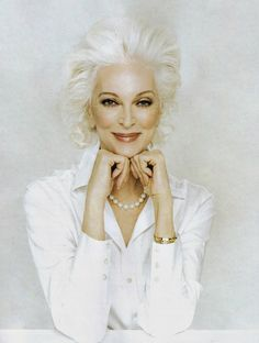 Carmen Dell'Orefice (born June 3, 1931) is 80 years old right now. She is the oldest model in the world modeling for the last 66 years, placing herself in the Guinness Book of World Records. Kudos and snaps to this beautiful woman !