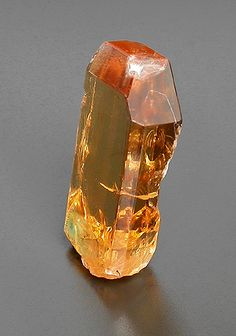 Danburite is a calcium boro silicate, found in a variety of places including Burma, Mexico and Madagascar.  The danburite from Mogok in Burma comes in the traditional clear, but also the champagne yellow pictured here in this 6 carat barion cut gem.  With a hardness of 7-7.5, danburite is plenty tough enough for any item of jewelry.