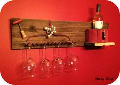 A wine station from salvaged materials ~ rusty rake handle, reclaimed wood, wooden pulley, vintage corkscrew