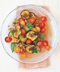 Bulgur Wheat Salad With Tomato and Eggplant | The incredibly versatile eggplant works in everything from Italian to Asian recipes. Bonus: Eggplantmakes a tasty substitute for meat, too.