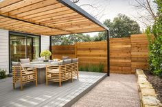 The perfect place to entertain guests or enjoy a meal al fresco, this unbelievable deck boasts teak furnishings, a gorgeous pergola and even a privacy fence.
