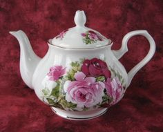 This is a pretty large English bone china 4-6 cup teapot made by Springfield, England in the pattern Summertime Rose with gold trim. The teapot was made in 2012 from an old Royal Patrician design and