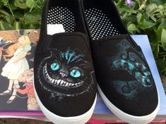 Alice in Wonderlands Cheshire Cat custom hand-painted shoes. Features the Cheshire Cat from the 2010 movie across both shoes.