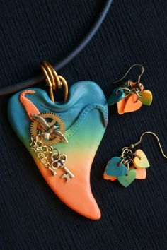 Tiki Sunset with earrings  polymer pendant and earrings with metal embellishment