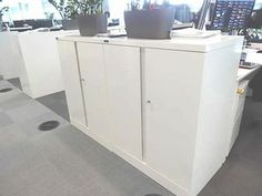 White Silverline Storage Cupboards - like new! £75 each + Vat. Ready to be delivered.