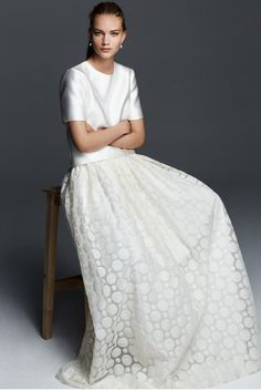 ANICE, two-piece dress with a short-sleeve top in double duchesse and silk blend, and a long organza skirt, decorated with milk-white polka dot embroidery. Slim, linear fit for a garment with minimal chic elegance. #maxmarabridal #weddingdress #wedding