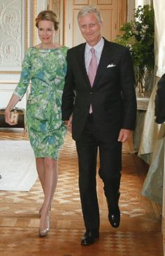 Belgium's Queen Mathilde and King Philippe arrive at a reception at the royal castle in Laeken, for ambassadors and their spouses, on 20.05. 2014.
