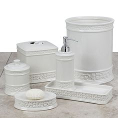 The lovely vintage design on the Cosmopolitan Bath Ensemble transforms your bathroom into a grandeur space. Lotion Dispenser measures H. Constructed of durable white ceramic with an elegant scrollwork design. Tissue Box Covers, Tissue Boxes, Primitive Bathrooms, Nautical Bathrooms, Bathroom Plants, Bathroom Curtains, Bathroom Accessories Sets, Covered Boxes, Bedding Shop
