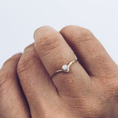 This delicate and classic opal ring features a hammered band and prong setting. The arched band adds a little funk to this simple opal ring. - Hammered band - 1mm opal stone - Prong set - 14K yellow g