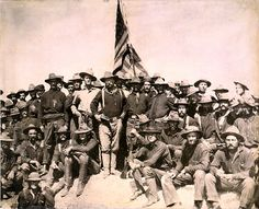 """""""Colonel Roosevelt and his Rough Riders at the top of the hill which they captured, Battle of San Juan""""  Date July 1898"""