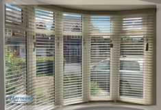 Wooden Blinds in Curved Bay Window Bay Window Blinds, Wooden Window Blinds, Bay Window Curtain Rod, Blinds For Windows Living Rooms, House Blinds, White Wooden Blinds, Patio Windows, Cellular Blinds, Bali Blinds
