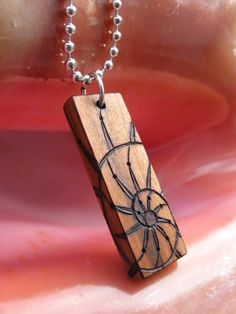 Nautilus Spiral on Cherry Wood Pyrography Pendant 1.5x by ArtAfire