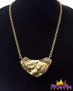 8-11. Rugby Rhino Copper and Bronze Pendant Necklace Our new runway jewelry on ETSY: https://www.etsy.com/shop/TheKingsThings