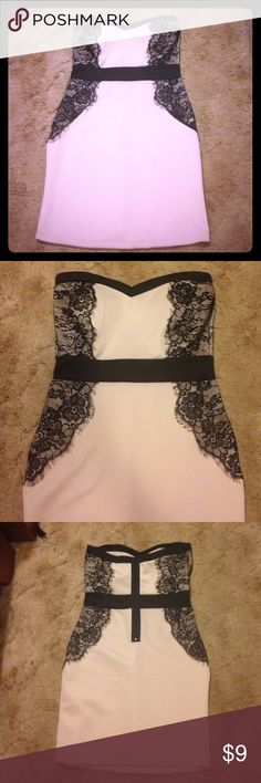 Lace mini dress Very slimming due to the lace side panels. Never worn. Dresses Mini