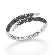 Roberto Coin http://www.vogue.fr/joaillerie/shopping/diaporama/diamant-noir-1/9760/image/596868