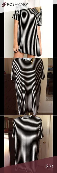 Brandy Melville Striped Top Black and white stripes. Super soft cotton. One size, measurements shown.  Can be worn as a mini dress or Tunic top. Great used condition, lots of stretch Brandy Melville Tops