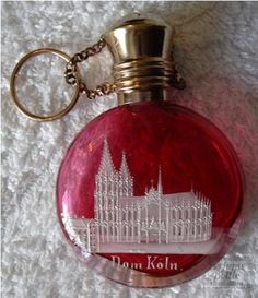 "victorian  cranberry glass, brass  ""Dom Koln""  Souvenir with enameled Cathedral of Cologne, brass chain & ring."