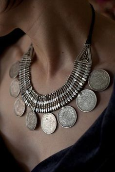 Silver Rupee Necklace from Himachal Pradesh, India. |  From 1920s colonial India. Intricately cut by a Himachali silversmith, it was worn as a charm for wealth and fortune. Each genuine British Indian Silver Rupee bears the image of King George V as Emperor and dates from around 1919. The coins were removable in case the wearer found herself in need of cash!