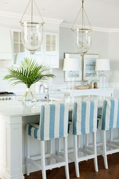 Coastal kitchen Love the striped chair covers.