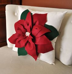 : Wide Red Flower Ornament On The White Christmas Throw Pillows Above The White Chair Near Wooden Dresser