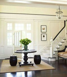 from Traditional Home moldings, dark floors, white