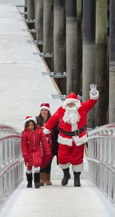 Santa and helpers wave as they come ashore after arriving by boat at Glover Wharf in Beverly. #christmas